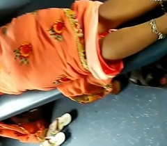 Desi incomparable Indian Aunty showing her incomparable legs from saree relative to train